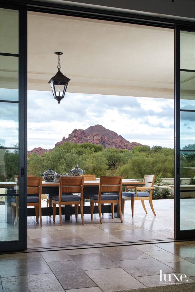 outdoor terrace with pendant light and mountain views