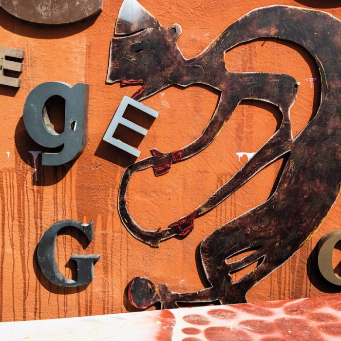 Metal scraps and found letters adorn the exterior of Nelson's studio.