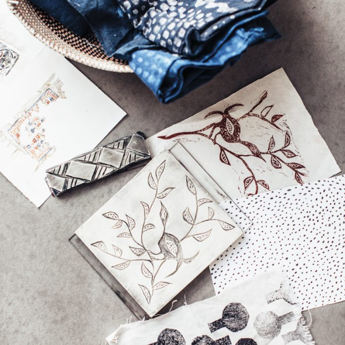 A selection of sketches fills a surface in Perdigon's studio. While she refines these as she develops her ideas, the finished designs still retain the presence of the human hand.