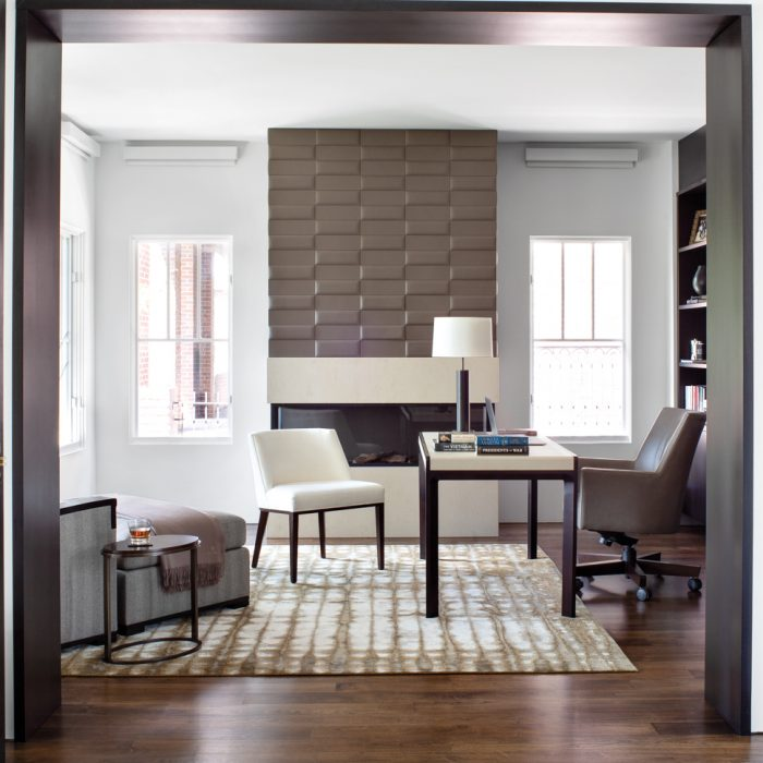 Leather tiles by Studioart over the fireplace give distinction to the office. Bright Chair Company seating surround a Troscan desk, and the lamp is by Orestes Suarez Lighting. Here and throughout the house the new floors are walnut with a light stain.