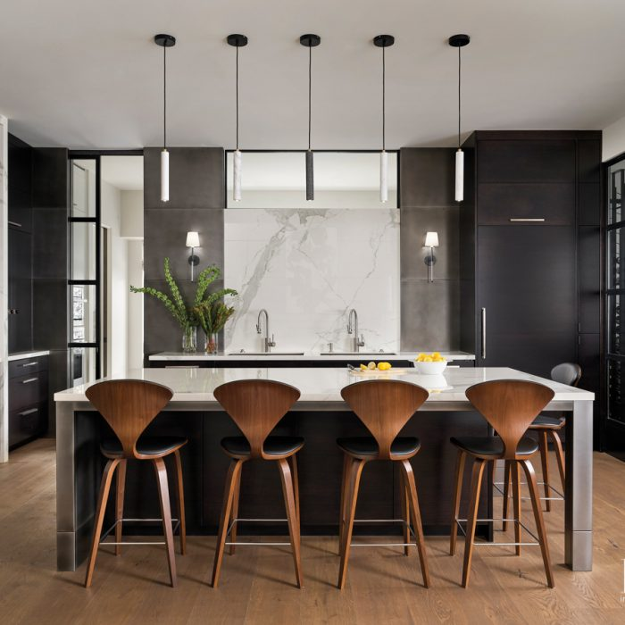 black white kitchen with row of pendants