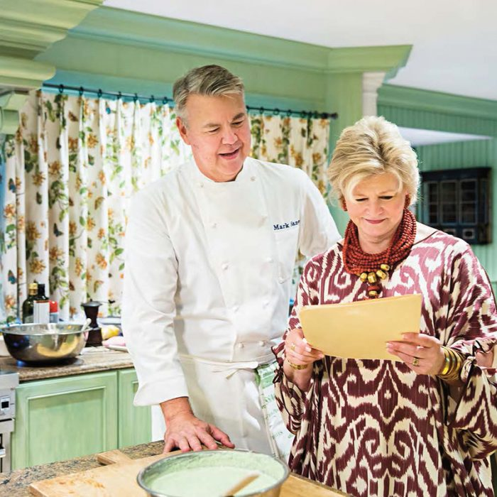 """Interior designer and hostess extraordinaire Charlotte Moss (shown with chef Mark Sanne) knows the secret to great entertaining is the thoughtfulness behind the gathering. Each small element--be it the flowers, the table linens or the invitations--makes a statement. """"The key is you,"""" she says. """"Put yourself in the details, and they'll be noticed and appreciated."""""""