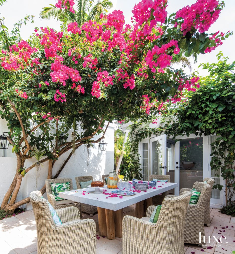 outdoor table with bougainvillea