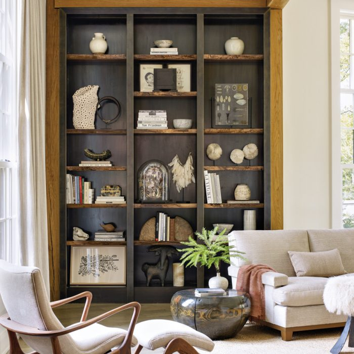 Designer Brad Ford created a country home in the Princeton suburbs for longtime clients with an interest in art and midcentury design. A corner of the living room features a Vladimir Kagan lounge chair and ottoman. Next to the Roman Thomas sofa is a metal table from Interieurs.