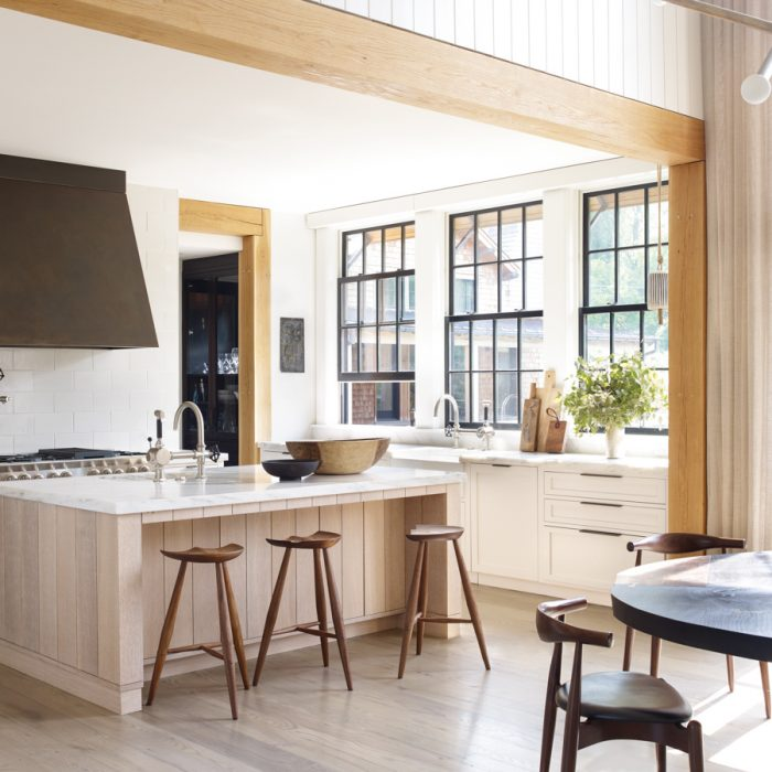 """""""They really enjoy cooking,"""" says Ford. """"The family is always together here in the kitchen."""" The hand-turned walnut barstools are from Culture + Commerce."""