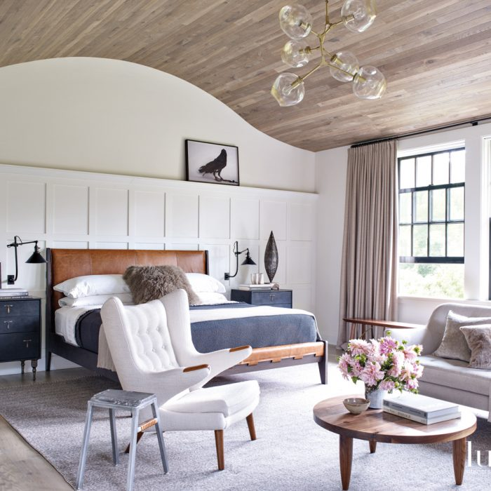 The designer chose a B&B Italia bed upholstered in Moore & Giles leather for the master bedroom. The Hans Wegner chair is from Wyeth and the coffee table is from Michael Robbins. Floating above the room is a Lindsay Adelman chandelier.