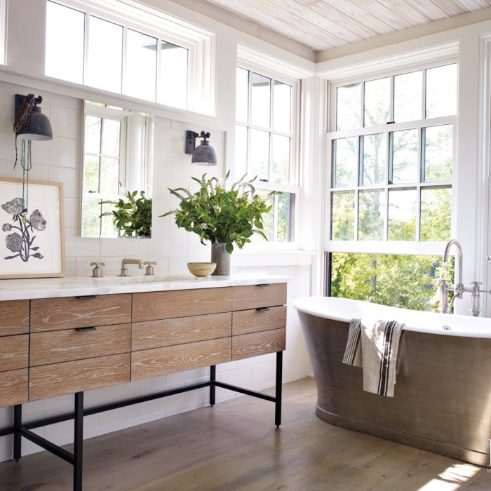 """""""I'm such a proponent of historical details. They give a room personality and add interest and texture,"""" says Ford of the master bathroom's retro-style tub and fixtures."""