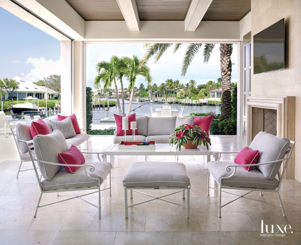outdoor terrace with white and pink furniture