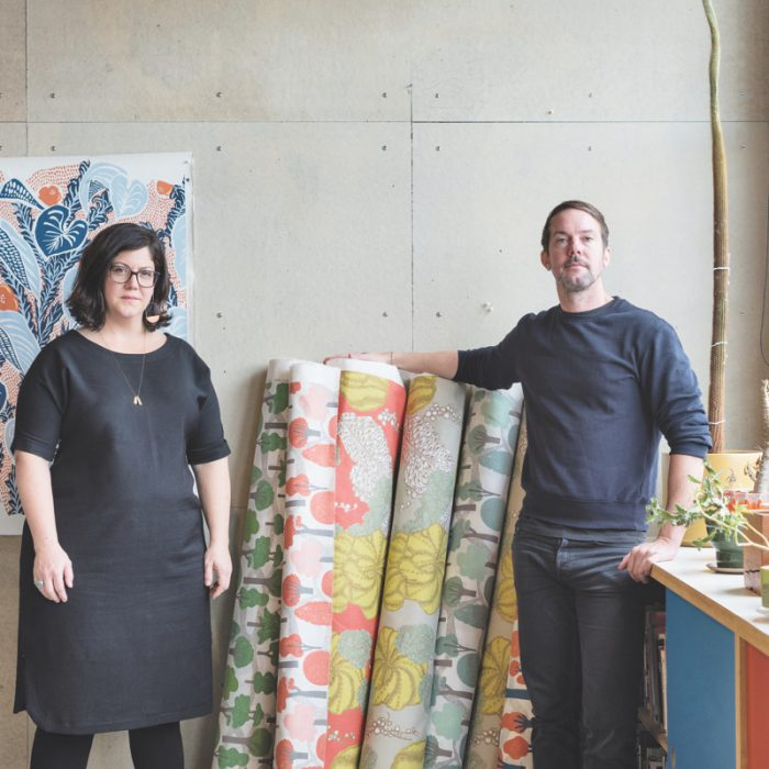 Makelike founders Mary Kysar and Topher Sinkinson pictured with some of their favorite prints.