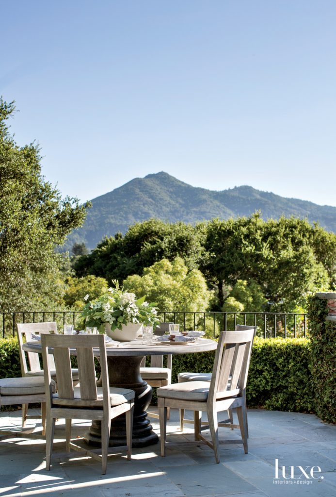 outdoor dining table with lush mountain views