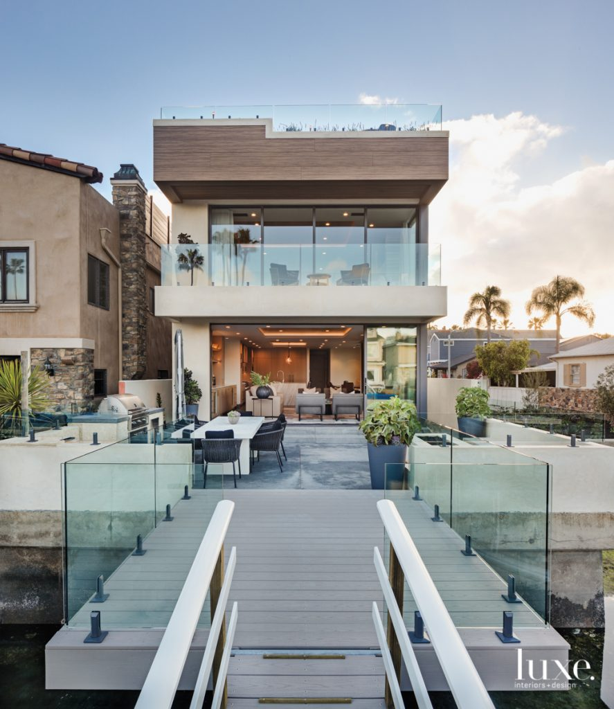 dock with glass railings and house exterior