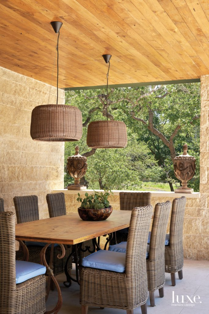 outdoor french dining table with woven pendants