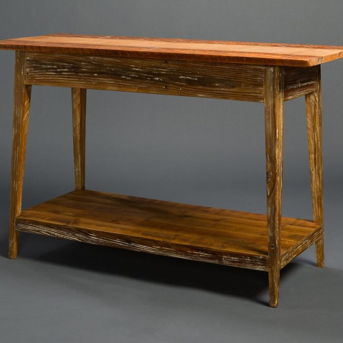 His Signature Console With Shelf, available in woods like heart pine and cypress, is a go-to for designer clientele.