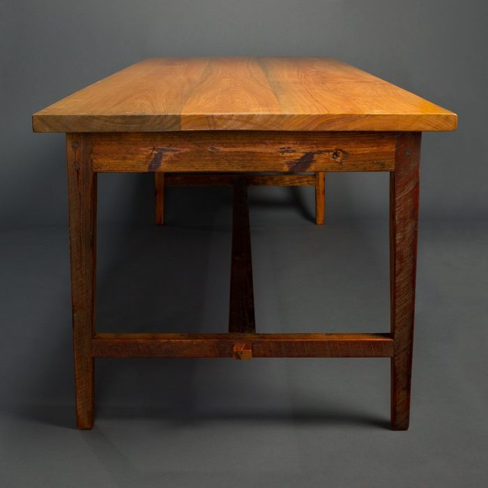 A side view of his Stretcher Base Signature Farm Table