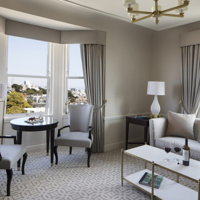 Suites feature a separate living/dining area designed with mid-century modern furnishings.