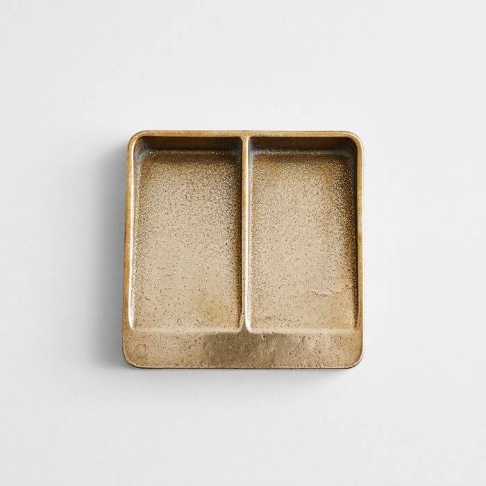 Wilson's elegant Vida Poche dishes, made in multiple iterations, are ideal for containing the contents of one's pockets.