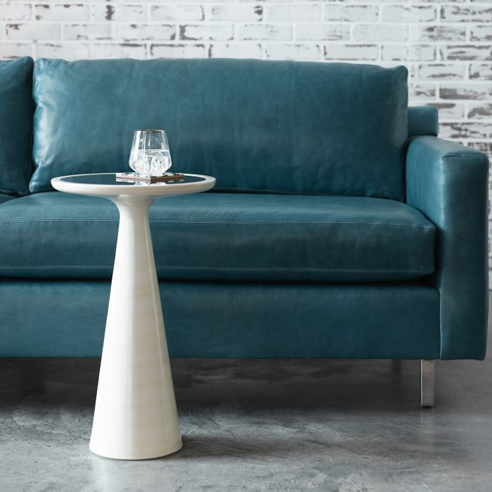 The low and luxurious Hunter leather sofa, available via special order in a fresh blue hue that could carry any room.