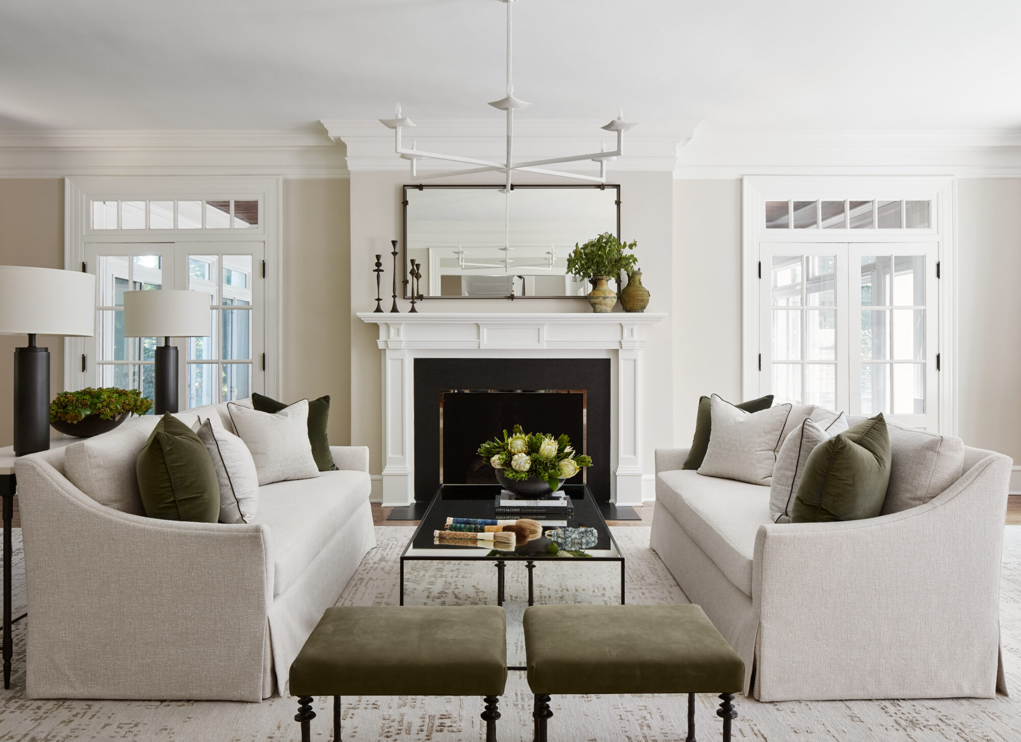 neutral living area with green accents, stools and pillows