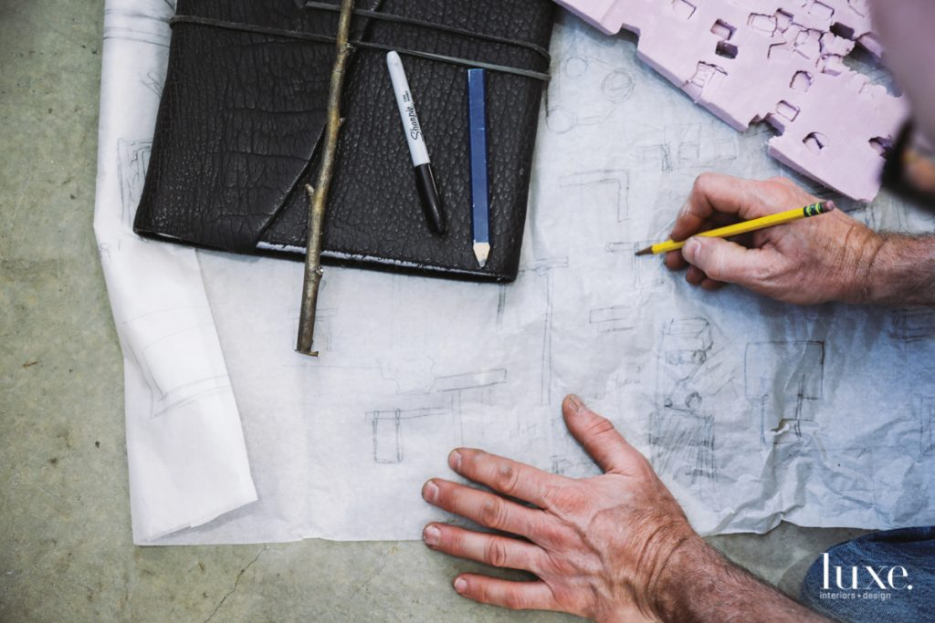 The artist and furniture designer sketches out ideas.