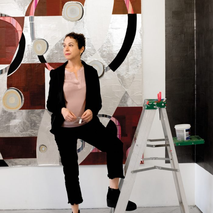"In her studio, textile artist Dianna Frid stands in front of Soledad from her ""Text Textile"" series."