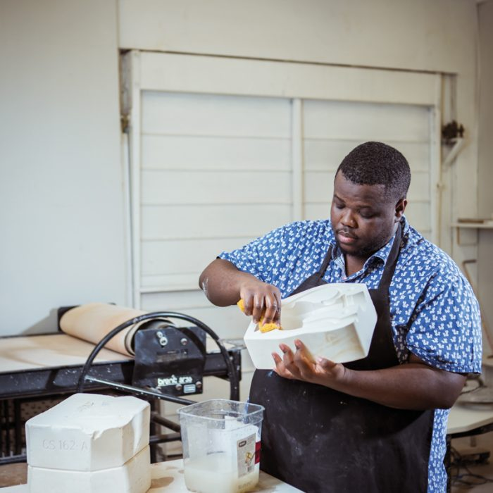 Miami artist Morel Doucet works on his ceramic pieces at his studio at the Bakehouse Art Complex.