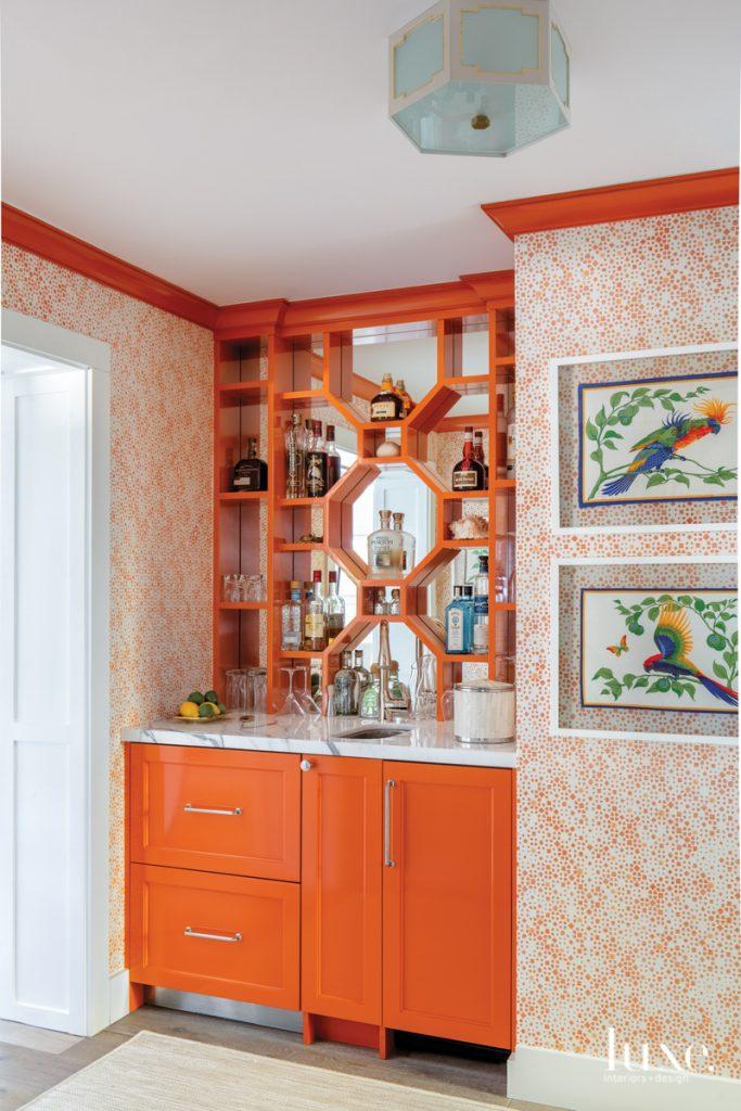 orange bar with framed vintage...