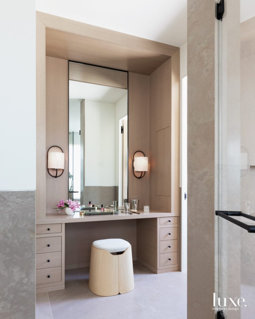 The serene master bathroom features...