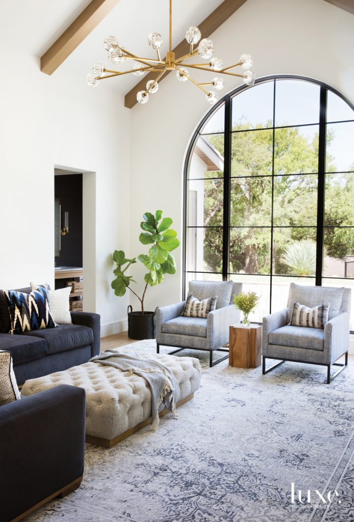 living room arched window armchairs