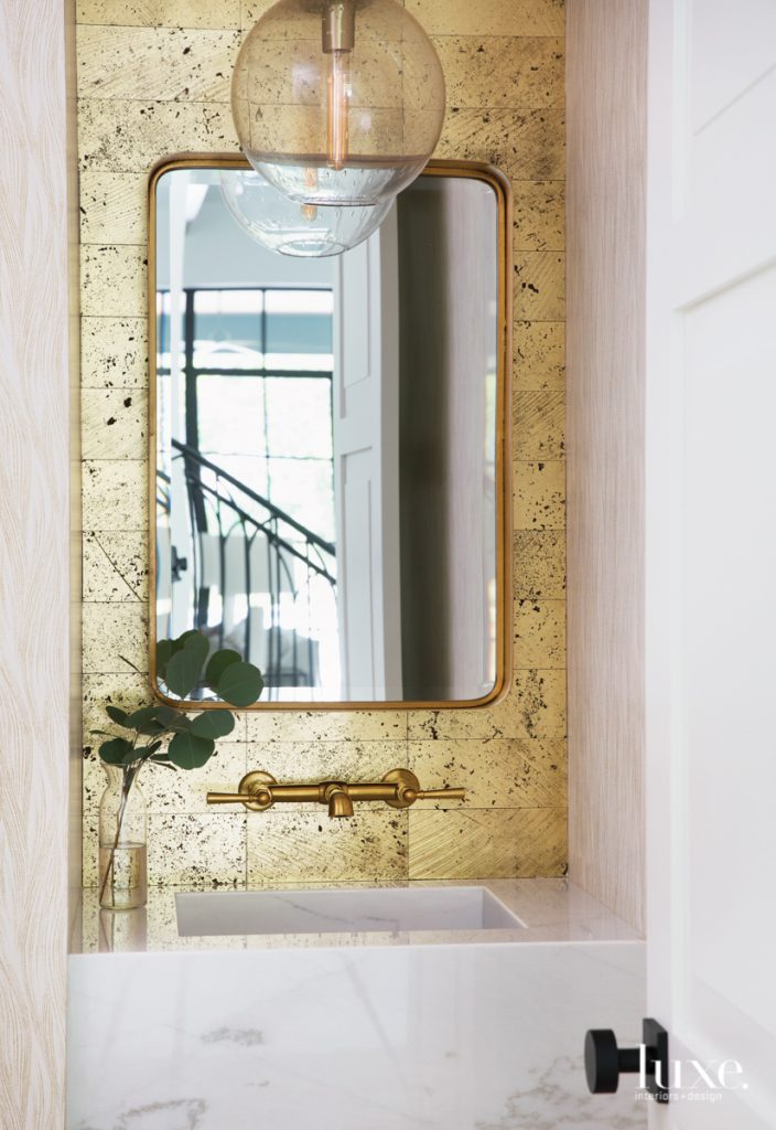 powder room gold-leaf travertine tiles
