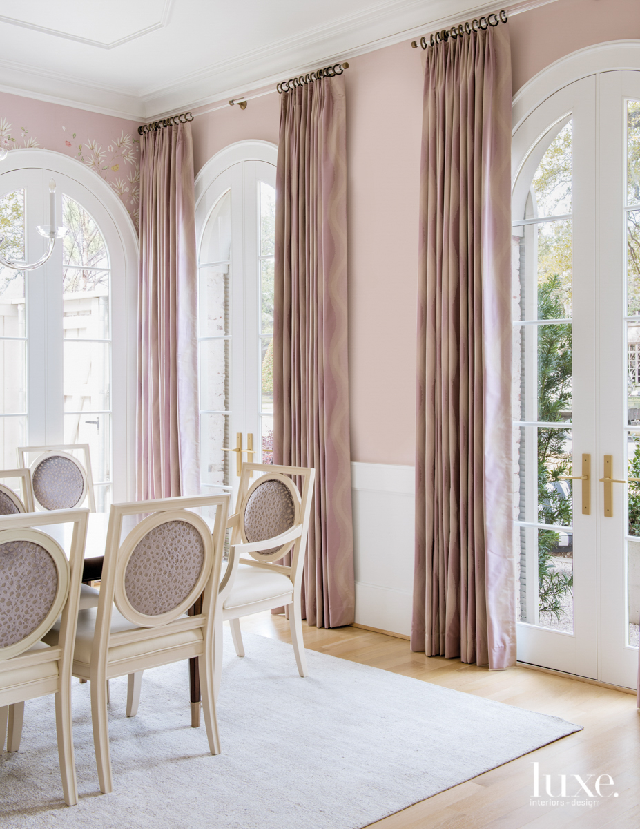 classic dining room with pink...