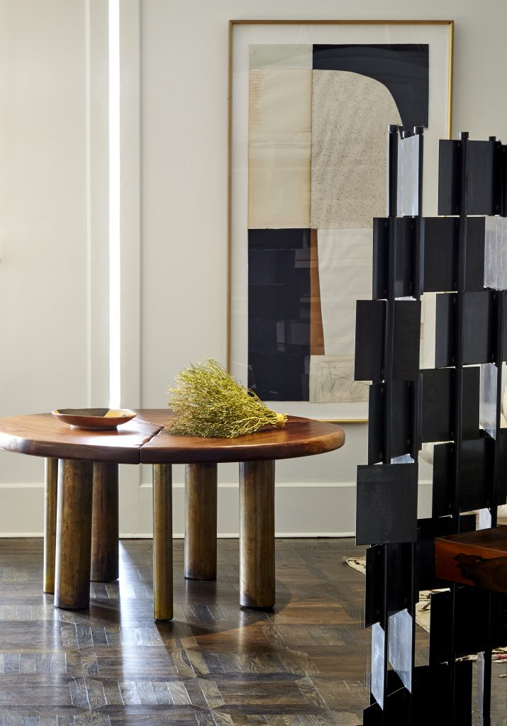 wood table and black shelf at chad dorsey design studio