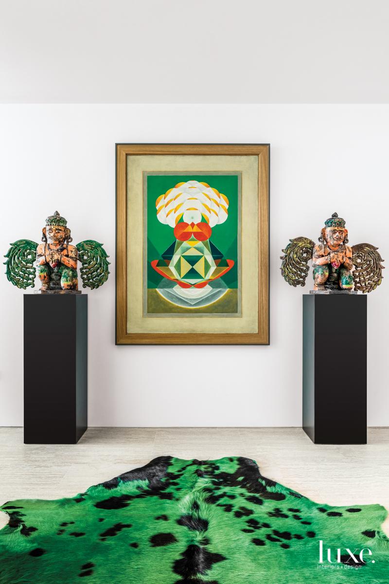 antique garuda sculptures on pedestals