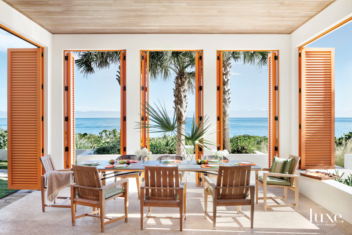 cabana with orange shutters and...