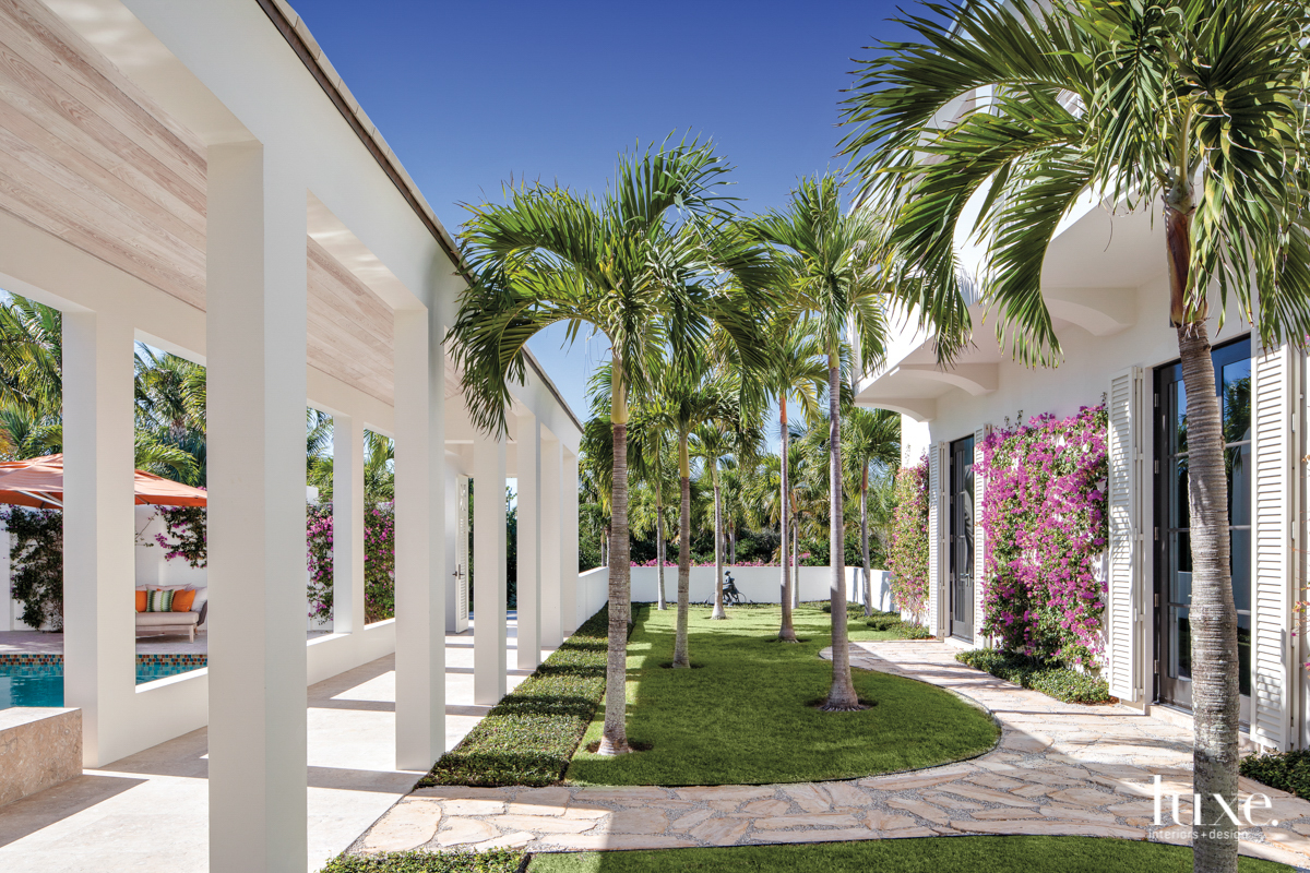 colonnade in front yard with...