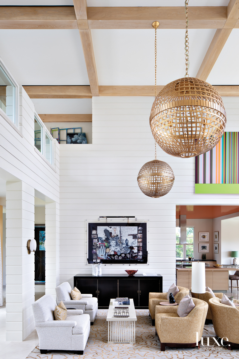 white living room with globe...