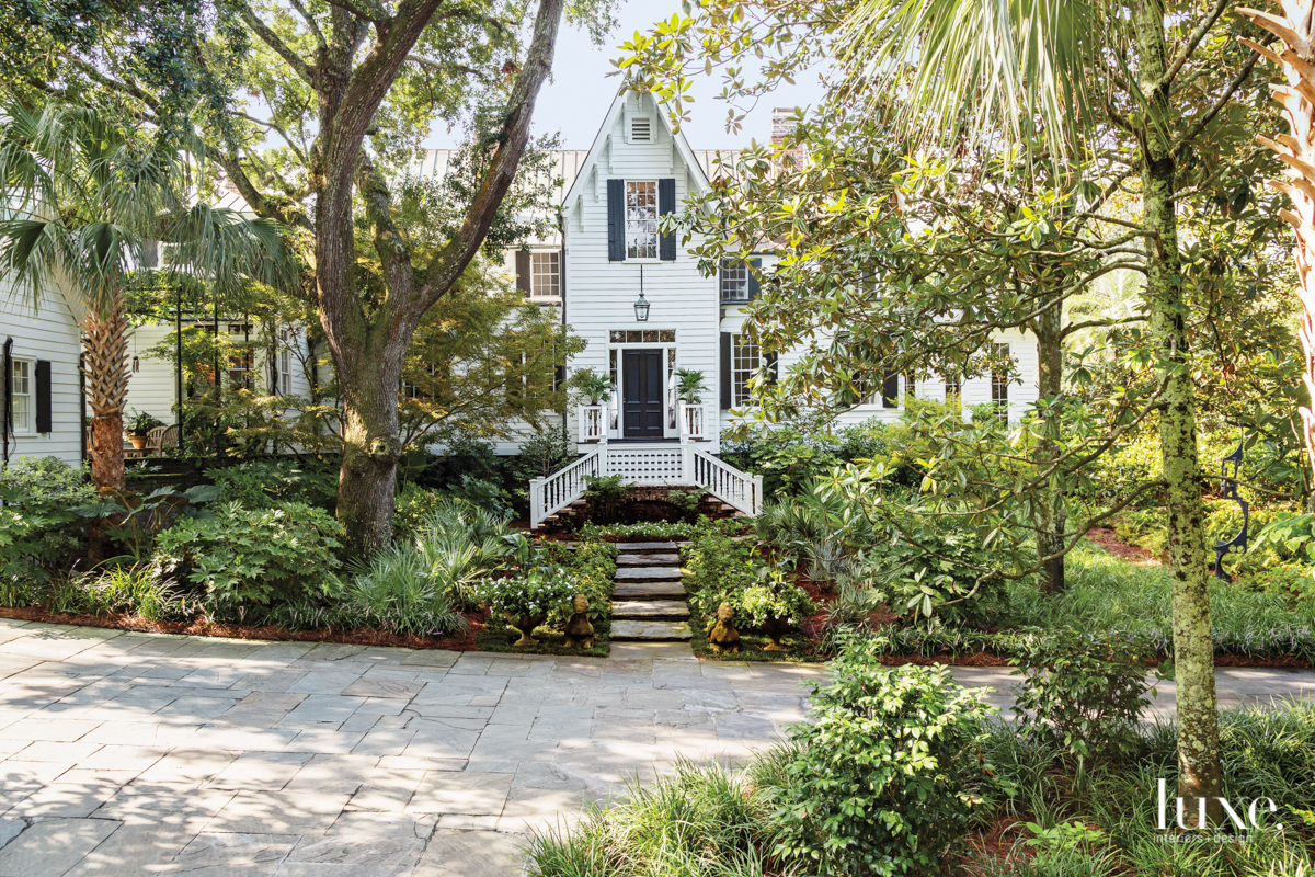 antebellum home exterior surrounded lush...