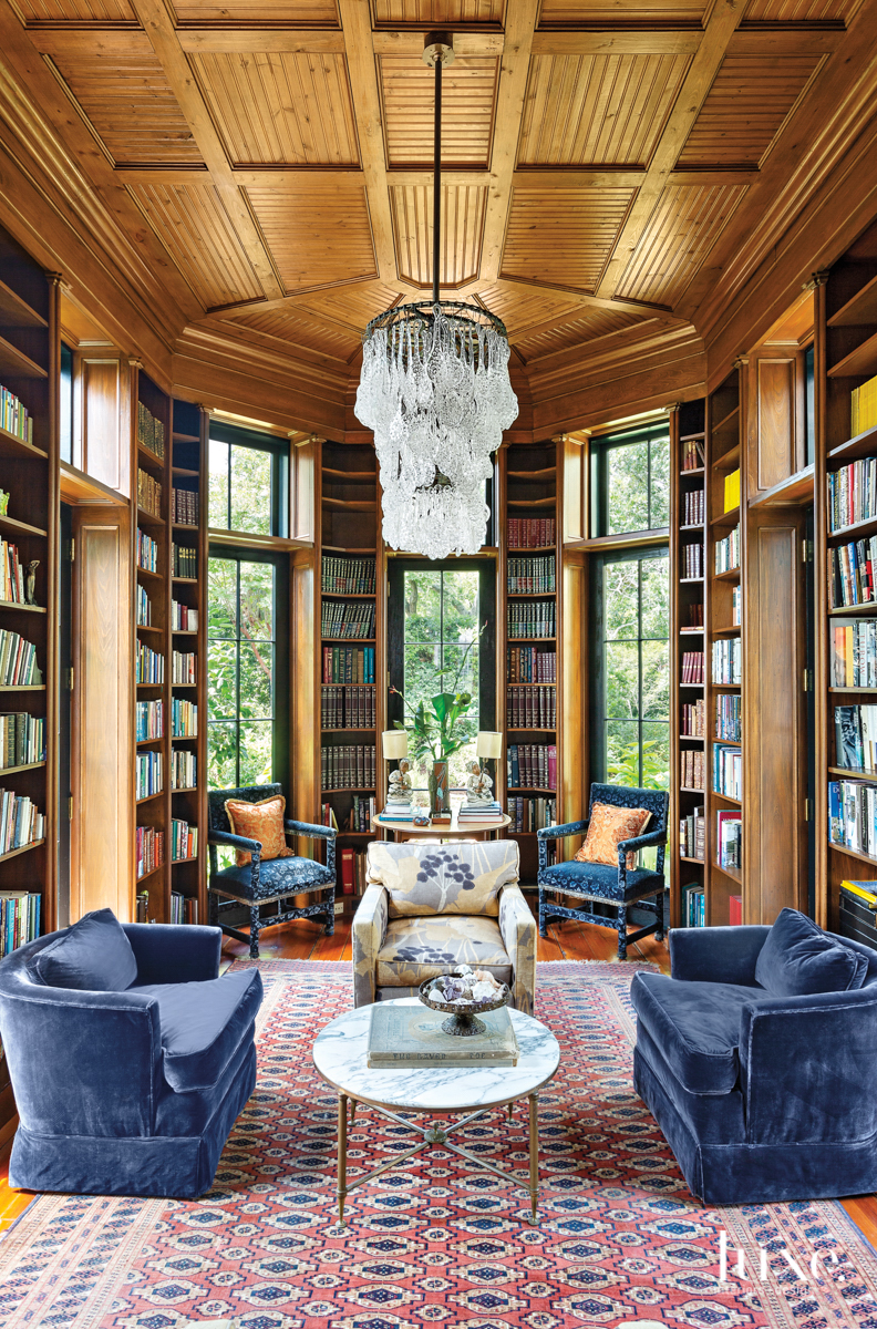 cypress-paneled library with antique blue...