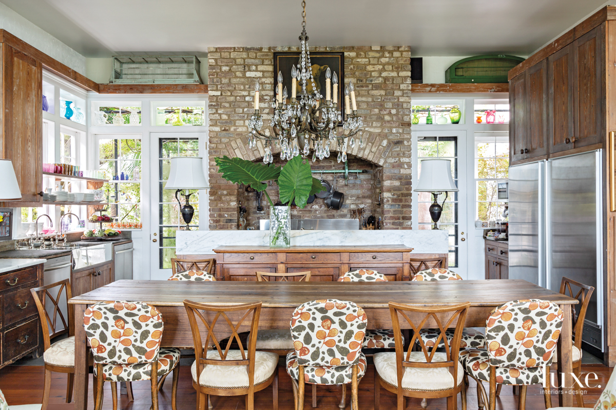 kitchen with french farm table and vintage chairs