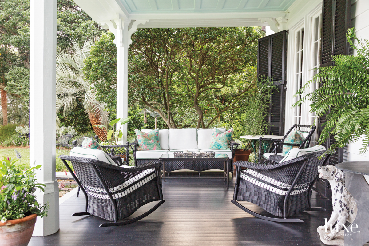 porch with black wicker furniture