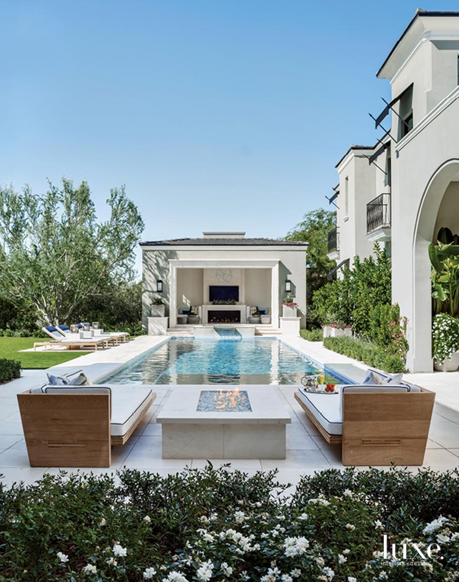 pool backyard with cabana and firepit
