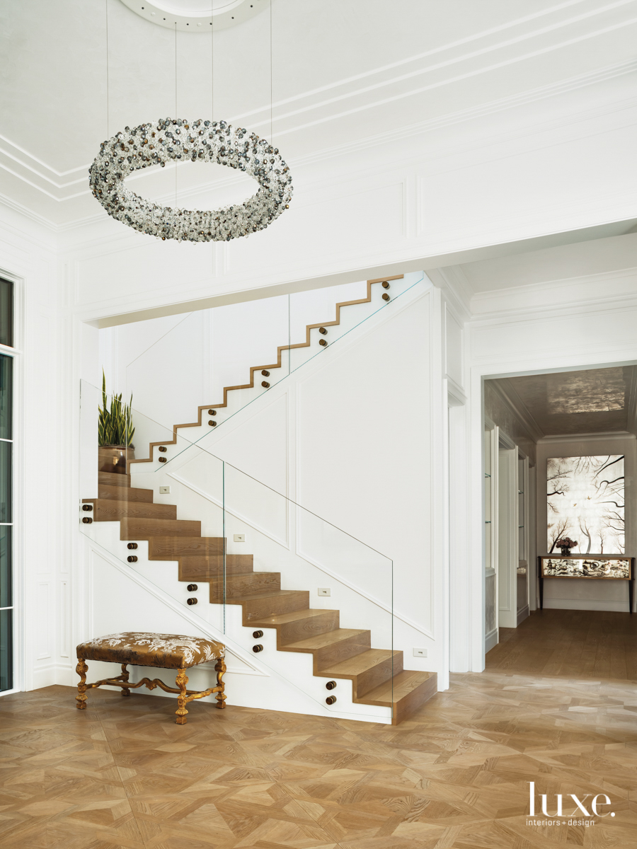 glass paneling staircase railing with eva menz chandelier