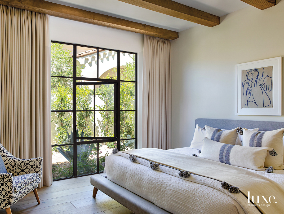 neutral guest room with west...
