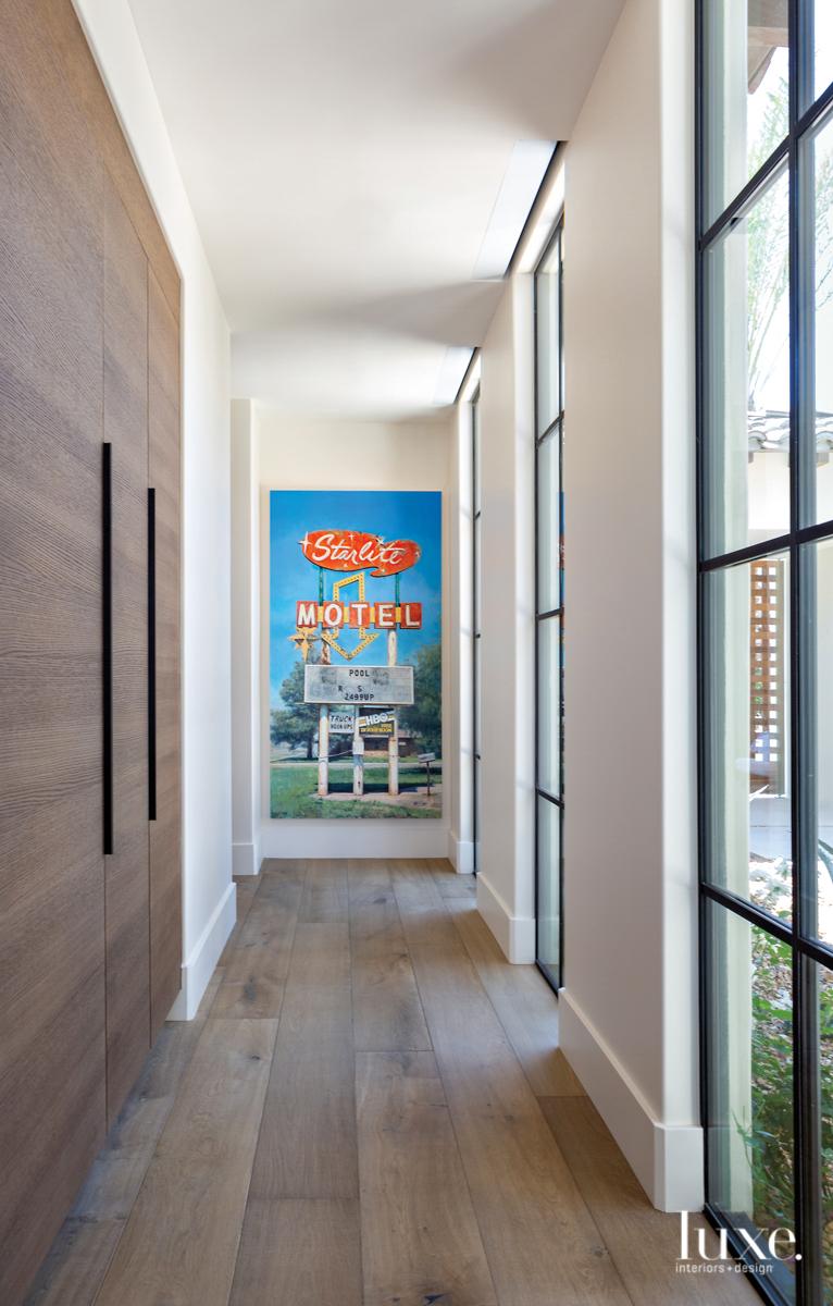 hallway with sleek cabinetry Jason...