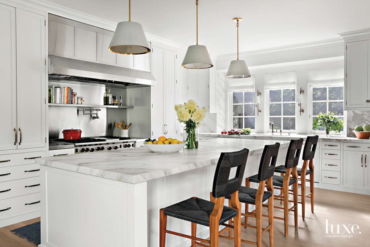 All-white kitchen with marble island...