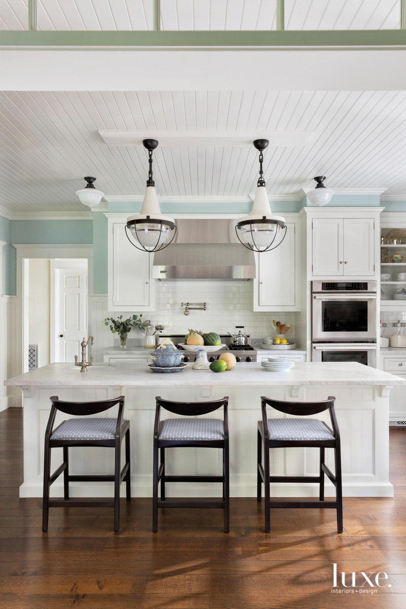 Pendant lights hang over a...