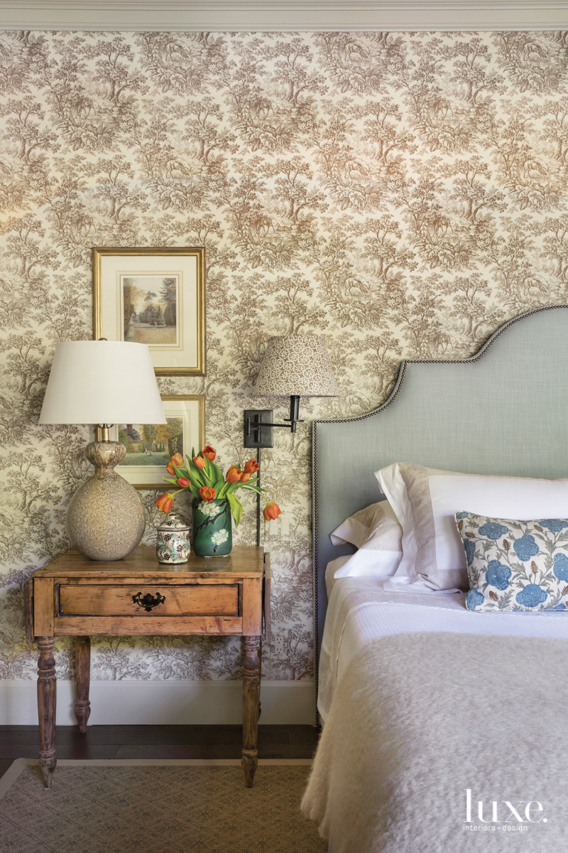 Guest bedroom with toile wallpaper...