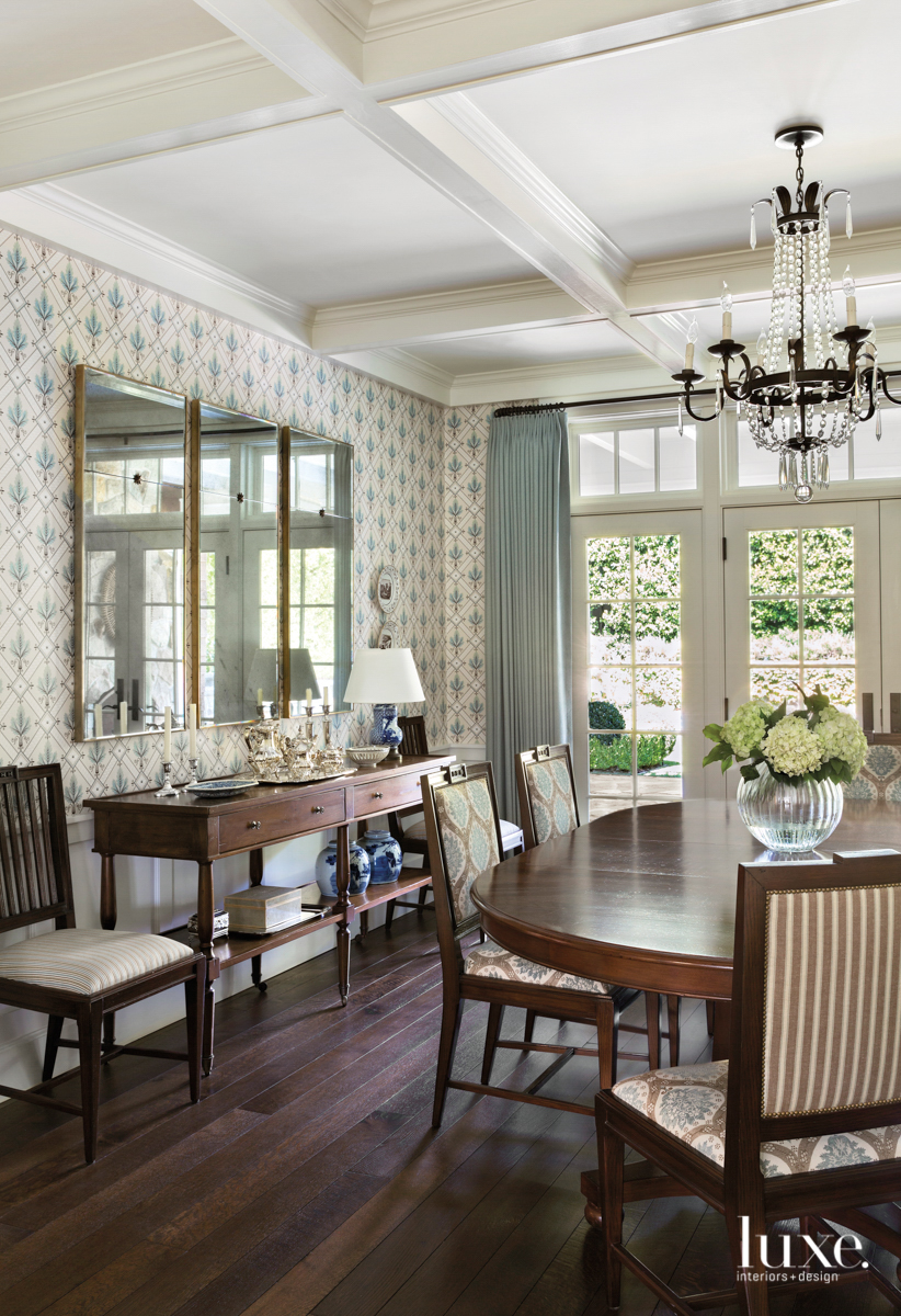 Dining room with wallpaper and...