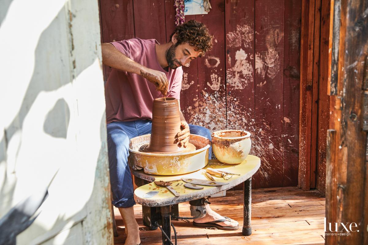 Joe Skoby at work at his pottery wheel