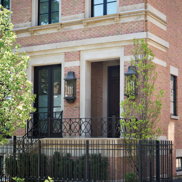 Who Says A Family-Friendly Home Can't Have Glam Accents? This Chicago Abode Gets It Right. chicgo home brick exterior