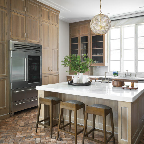 Who Says A Family-Friendly Home Can't Have Glam Accents? This Chicago Abode Gets It Right. light wood kitchen reclaimed brick flooring